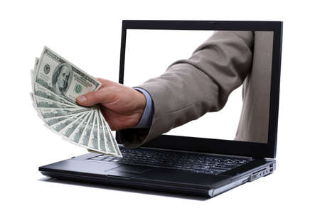 Holding one hundred dollar bills through a laptop screen concept for internet e-commerce, paying and electronic banking photo