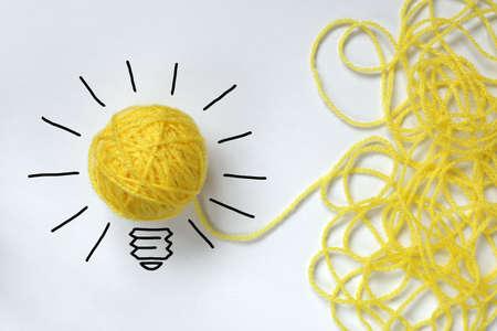 Inspiration Wolle Glühbirne Metapher für gute Idee