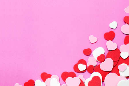 Red, pink and white heart shape valentines day confetti background photo