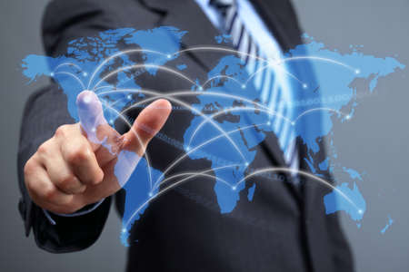 global direction: Global communications network, businessman with futuristic world map concept for business and social networking media Stock Photo