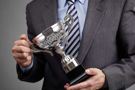 trophy: Businessman celebrating with trophy award for success in business or first place sporting championship win