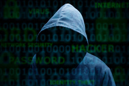 computer hacker: Computer hacker silhouette of hooded man with binary data and network security terms Stock Photo