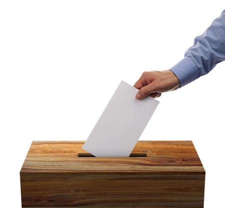 Ballot box with person casting vote on blank voting slip photo