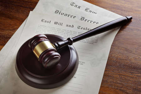 Gavel and legal papers last will and testament, divorce decree and tax law concept for the judicial system  photo