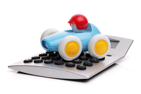 Toy car and calculator concept for buying, renting, fuel or service and repair costs photo