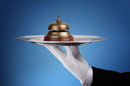 party tray: Hotel reception service bell on a silver tray concept for assistance and support