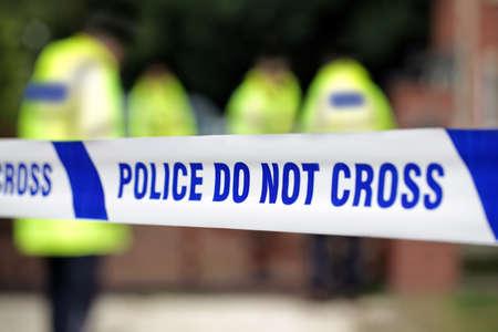 crime scene investigation: Crime scene investigation police do not cross boundary tape investigating police team Stock Photo