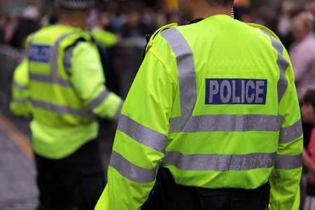 police arrest: Police in hi-visibility jackets policing crowd control at a UK event