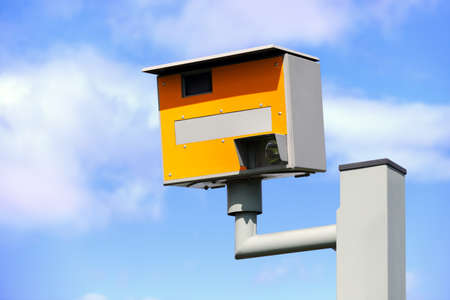 UK static speed or safety camera against a blue sky photo