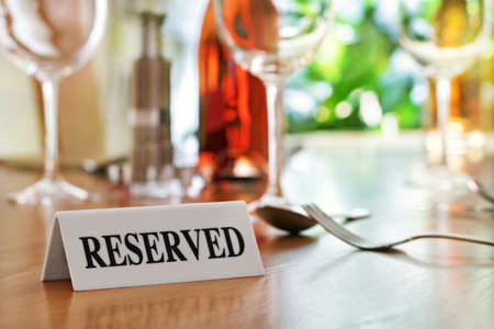 reserved: Reserved sign on a restaurant table Stock Photo