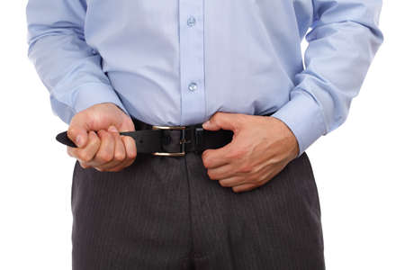 economic depression: Businessman tightening his belt concept for recession or economic depression