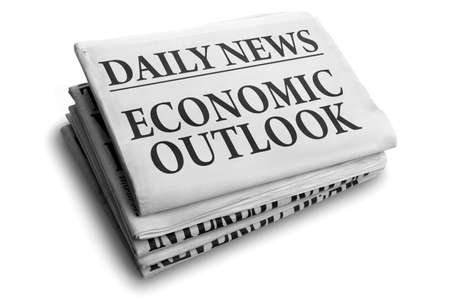 Daily news newspaper headline reading economic outlook concept for financial forecasting photo