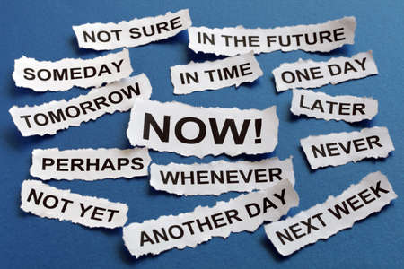 tomorrow: Concept for procrastination and urgency with torn newspaper headlines excuses reading later, one day, tomorrow, someday, whenever etc Stock Photo