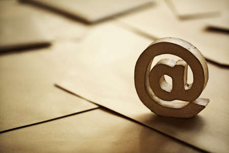E-mail @ symbol on brown business letters Stock Photo