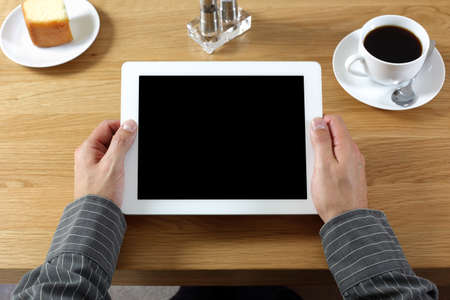 medias: Digital tablet with blank screen in coffee shop cafe