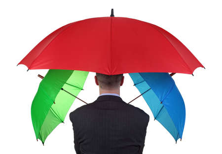 adequate: Confident businessman with three umbrellas concept for more than adequate ample insurance cover or failsafe backup plan Stock Photo