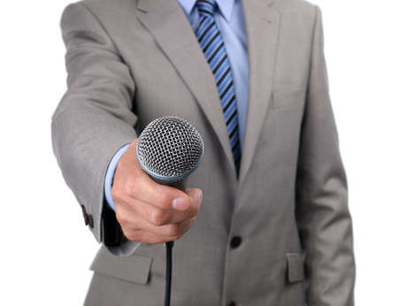 public address: Businessman, journalist or reporter holding a microphone conducting an interview