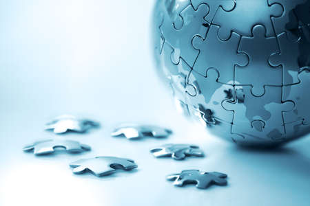 globe puzzle: Global strategy solution concept - earth jigsaw puzzle Stock Photo