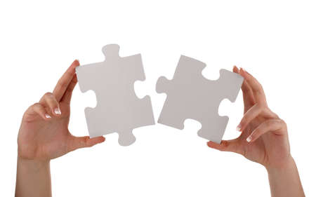 things that go together: Puzzle pieces joining together concept for unity, teamwork or success with blank white face for message Stock Photo
