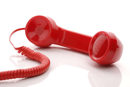 Red old fashioned telephone handset isolated on a white concept for urgent or important customer support call  photo
