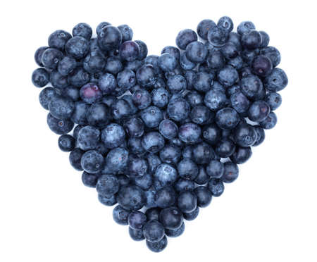 Blueberry heart shape symbol concept for healthy eating and lifestyle photo