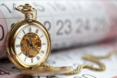 pocket watch: Pocket watch against a calendar concept for planning or scheduling