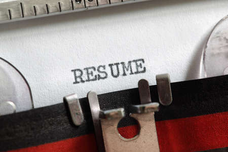 Resume written on an old typewriter concept for job search and recruitment photo