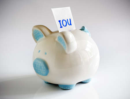 IOU note in piggy bank signifying debt or financial problems Stock Photo - 24930995