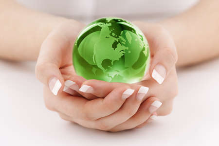 conservation: Globe in womans hands concept for protecting the earth and environmental conservation