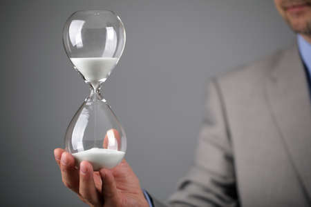 Hourglass timer concept for business deadline and leadership photo
