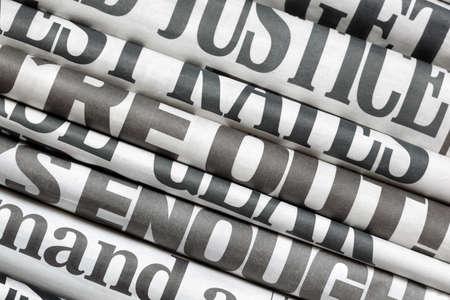 broadsheet newspaper: Newspaper headlines side on in a stack of daily newspapers