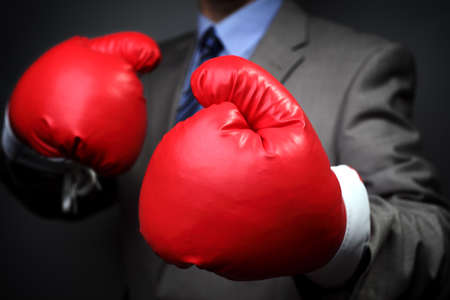 competitive business: Tough competitive business concept businessman wearing boxing gloves