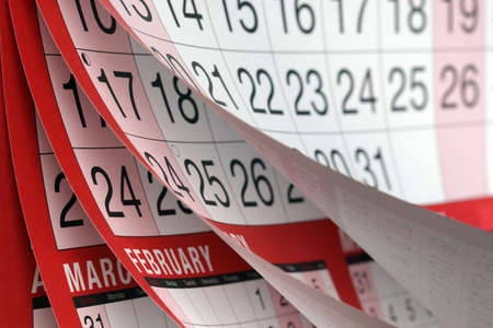 annual events: Months and dates shown on a calendar whilst turning the pages Stock Photo