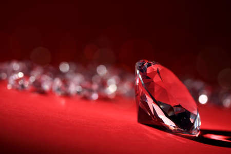 diamond shaped: Diamonds on red background with focus on one in foreground Stock Photo