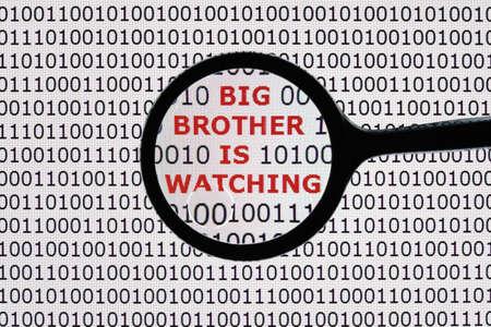 インターネット セキュリティ概念単語ビッグブラザーが見ている虫眼鏡でデジタル タブレット画面 写真素材