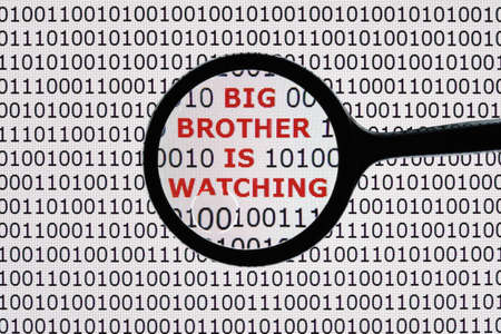 big brother spy: Internet security concept the words big brother is watching on a digital tablet screen with a magnifying glass
