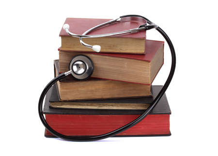 Stethoscope on old hardback books concept for medical research or ethic photo