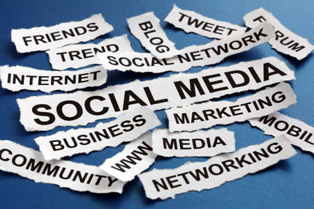 blog: Social media concept torn newspaper headlines reading marketing, networking, community, internet etc