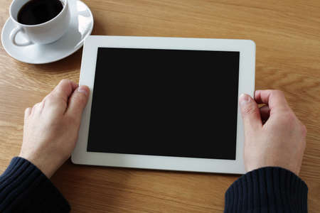 Digital tablet with blank screen in coffee shop photo