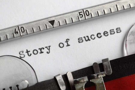 Story of success written on an old typewriter photo