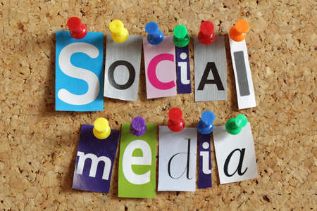 Social media from cutout newspaper headlines pinned to a cork bulletin board Stok Fotoğraf
