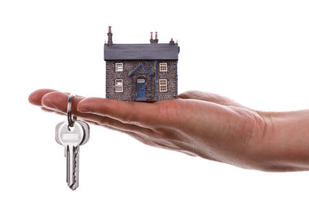 House keys and model house concept for selling or moving home photo