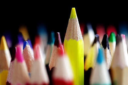 out of order: Standing out from the crowd concept with colored pencils Stock Photo