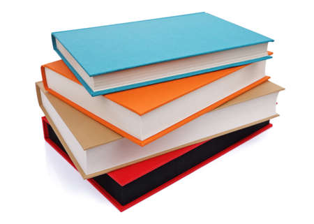 Stack of multi colored books isolated on white photo