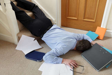 Business man falling down the stairs in the office concept for accident and insurance injury claim at work photo
