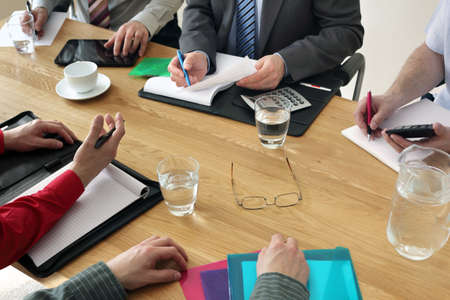small table: Business meeting with people working as a team in the office Stock Photo