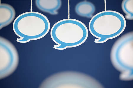 chat bubble: Blank white speech bubbles hanging from string