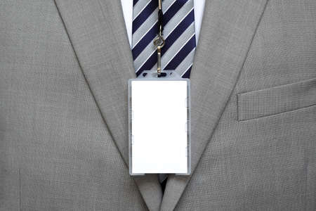 badges: Blank identity name tag on a businessman suit on a lanyard
