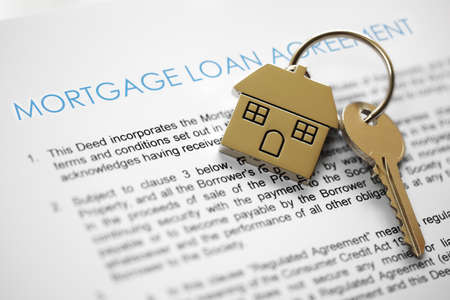 Mortgage loan agreement application with house shaped keyring Stok Fotoğraf - 25087474