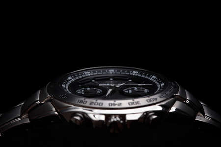 Wrist watch on black background photo